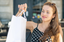 a young woman holding shopping bags