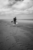 father and son walking on a beach