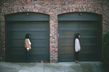 friends standing in front of doors