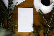 blank paper, pine, and coffee mug