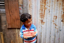 a toddler holding a slice of watermelon