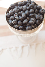 silver bowl of blueberries