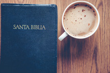 Santa Biblia and cappuccino