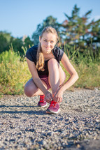 jogger tying her shoes