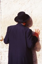 Orthodox Jew kissing the wailing wall