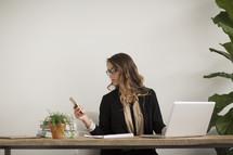 a businesswoman sitting behind a desk