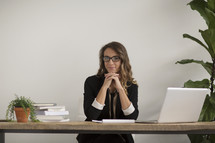 a businesswoman sitting behind a desk