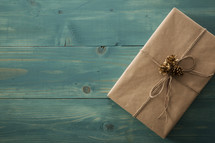a present wrapped in brown paper