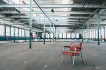 chair in an empty warehouse