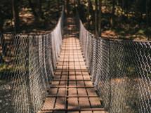 swinging bridge over a river
