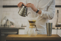 man using Chemex pour over coffee filter