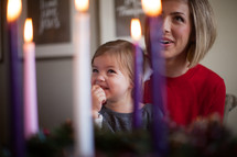 mother and daughter looking at an Advent wreath