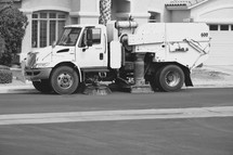 street sweeper cleaning a neighborhood street
