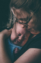 Mother consoles upset, crying infant.
