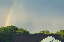 rainbow in the sky over a roof