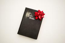 Christmas bow and Holy Bible