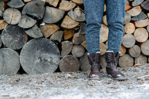 boots and stacked firewood