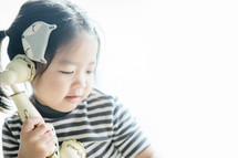 toddler with a vintage telephone