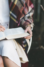 a woman reading a Bible in her lap