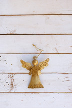 gold angel on white shiplap