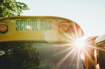 sun burst over a school bus