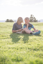 brothers reading Bibles in the grass