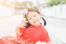 smiling girl in traditional Chinese dress
