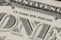 "Closeup of a dollar bill showing ""In God We Trust"""