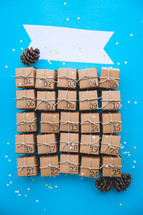 advent calendar presents and pine cones