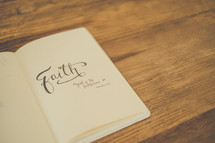 Book of faith on a wooden table.