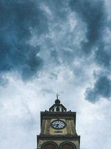 clock tower and clouds in the sky