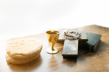 communion bread and wine, with Bible and cross