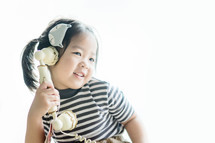 little girl talking on an antique phone
