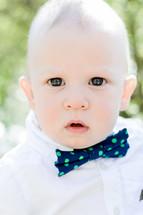 bright eyed baby boy in a bowtie