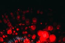 red bokeh lights on black