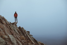 man standing at the edge of a cliff