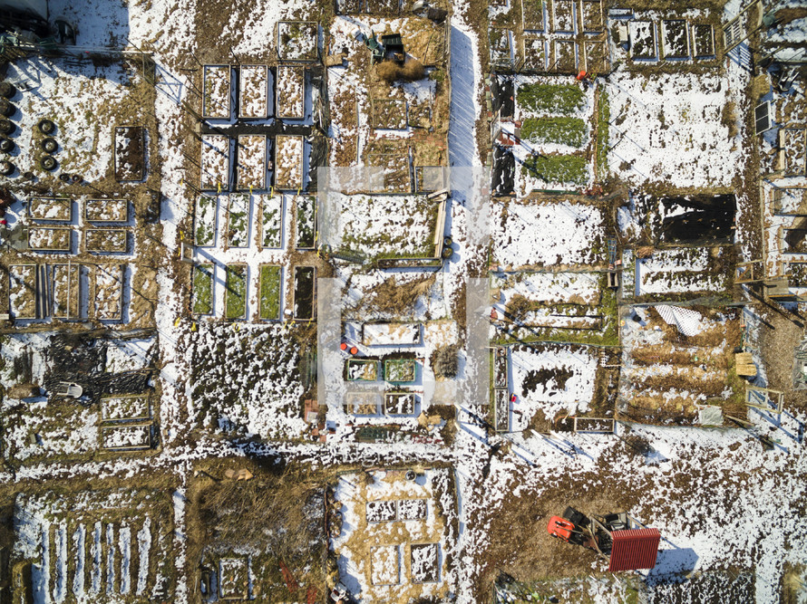 aerial view over snow on farmland