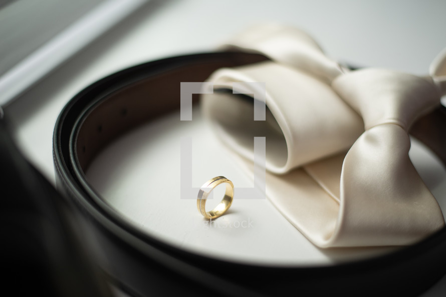 gold wedding ring and tie