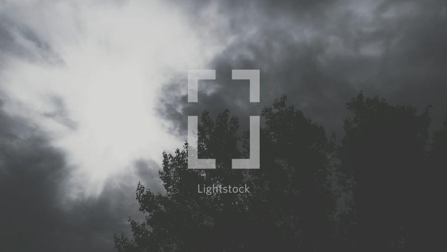 Light breaking through dark clouds
