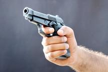 man holding a hand gun