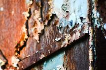 key in a lock on a rusty metal door