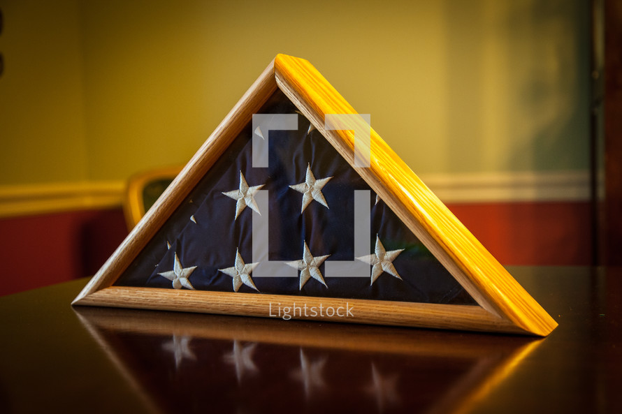 an American Flag in display case