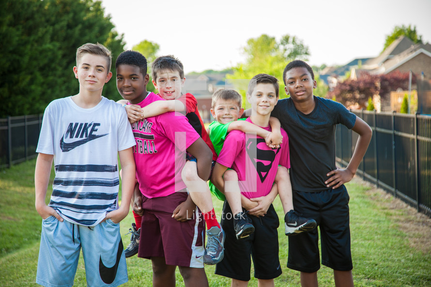 group of boys standing together outdoors
