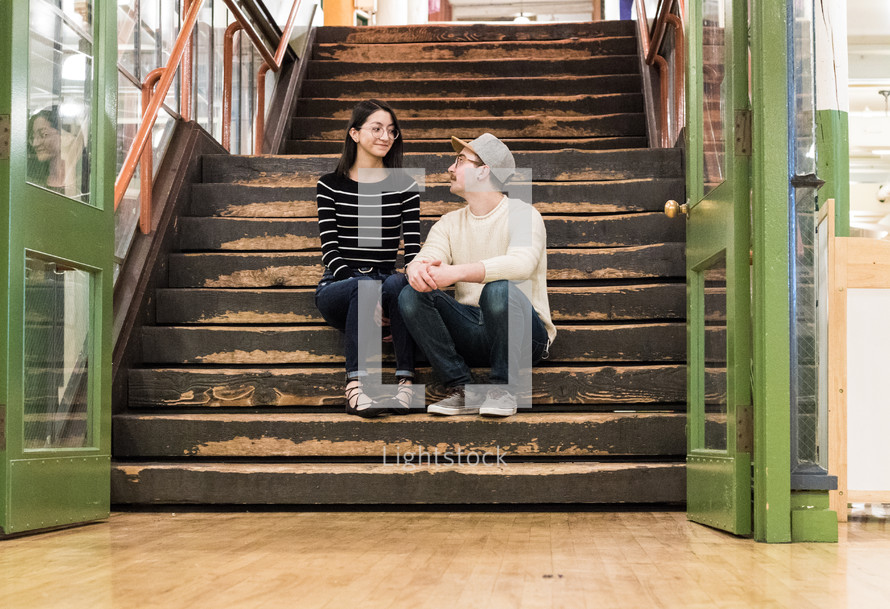 a couple sitting in a stairwell