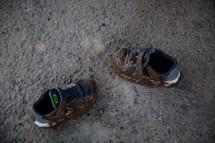 muddy toddler sneakers