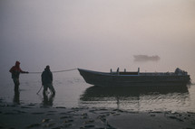 anchoring a boat on shore