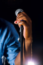 hand gripping a microphone