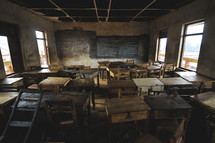 Desks in an empty school house in Africa