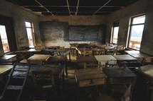 Desks in an empty school house in Africa
