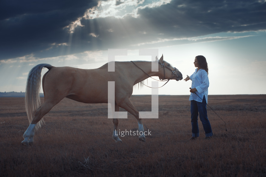 a woman training a horse